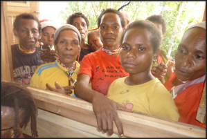 Villagers peeping through the window during jungle clinic time. I love this photo and the curiosity it captures.